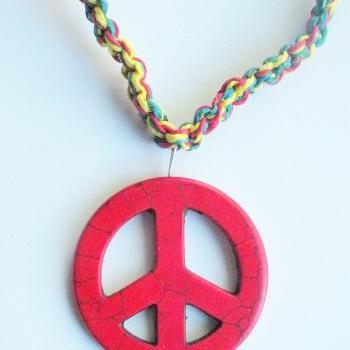 Large red peace sign macrame hemp necklace in Rasta shades